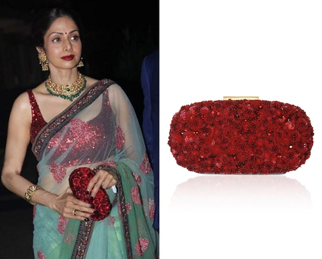 Red hand crusted leather minaudiere oval clutch by Sabyasachi
