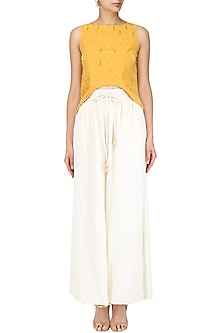 Mariegold Yellow Asymmetric Top with Ivory Pants Set by Aashna Behl