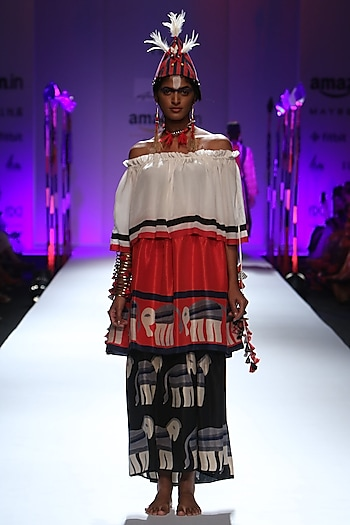 Red, black and white three tier elephant printed off shoulder dress by Anupamaa Dayal