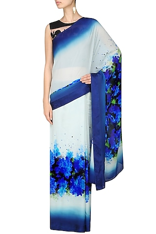 """Off white and blue """"Indigo"""" floral handpainted saree with an unstitched blouse piece by Aadi Shop By Shalini"""
