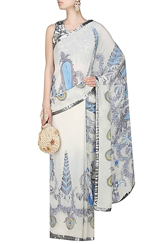 """Off white and blue """"Orchid"""" floral handpainted saree and embroidered blouse set by Aadi Shop By Shalini"""