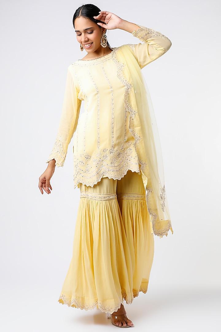 Yellow Thread Embroidered Kurta Set by anuradha grewal