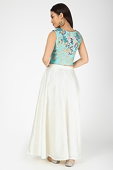 Turquoise Embroidered Jacket With White Lehenga by Aharin India