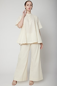 Ivory Palazzo Pants With Mop Buttons by Ahmev