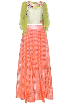 Lime ruffle embroidered top with peach lehenga skirt by Aharin India