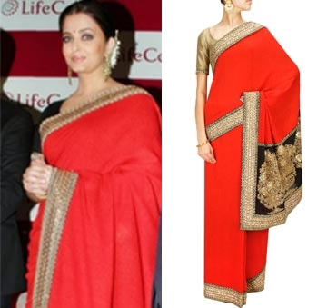 Red embroidered fletcher sari with gold blouse piece by Sabyasachi
