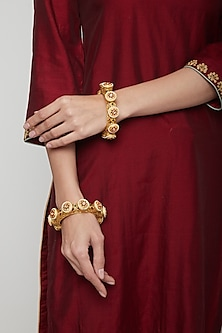Gold Plated Red & Green Stones Bracelets by Anjali Jain