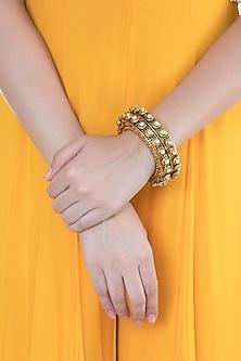 Gold Finish Onyx Stones & Kundan Bangles by Anjali Jain