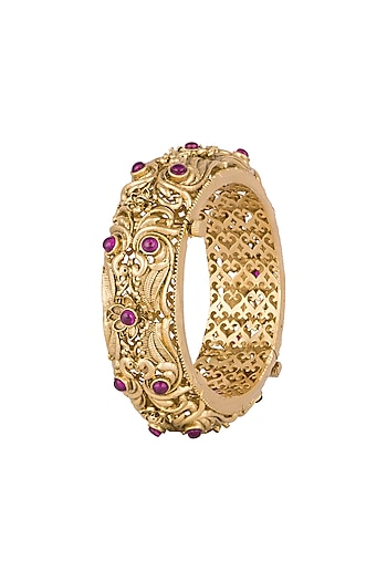 Gold Finish Onyx Stones Carved Bangles by Anjali Jain