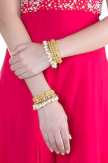 Gold Finish Onyx Stones & Pearls Bangles by Anjali Jain