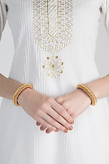 Gold Polish Gold Beads Roped Bangles by Anjali Jain