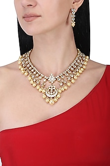 Gold plated kundan and pearls necklace set by Anjali Jain