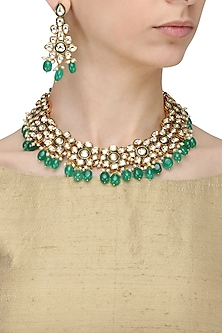 Gold Finish Kundan and Green Stone Flower Necklace Set by Anjali Jain