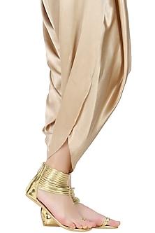 Gold ankle length gladiator by Aprajita Toor
