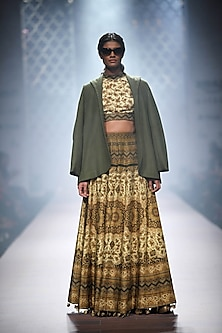 Pale and olive green printed skirt and blouse set by Ashima Leena