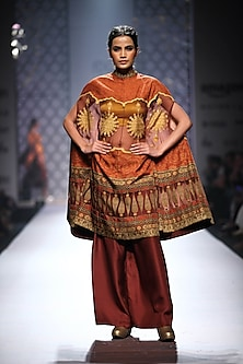 Maroon and mustard printed cape with mustard bustier and maroon palazzos by Ashima Leena