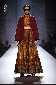 Maroon and mustard different print stitched together skirt and blouse set by Ashima Leena