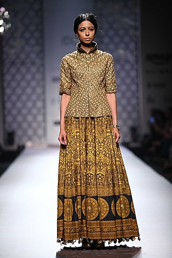 Gold fully embellished jacket with black and mustard printed skirt by Ashima Leena