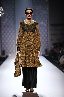Black and mustard organza detailing kurta with black palazzos by Ashima Leena