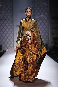 Mustard, maroon and olive green printed lehanga saree with bishop sleeves printed blouse by Ashima Leena