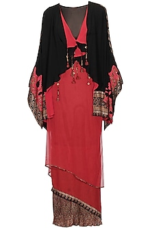 Black and red brocade textured cape and red draped skirt set by Ashima Leena