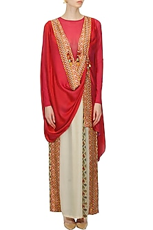 Red printed poncho cape and beige fusion saree style trouser pants set by Ashima Leena