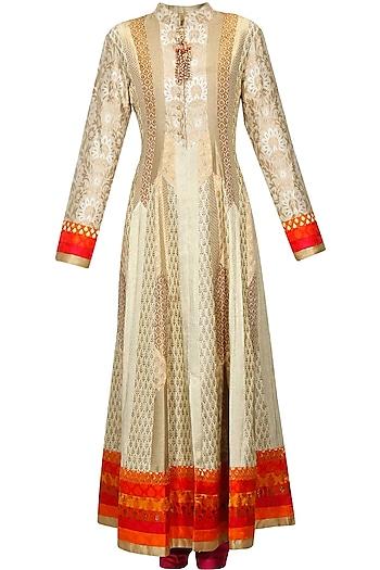Gold and beige brocade textured flared anarkali set by Ashima Leena