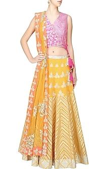 Yellow gota patti work lehenga and bright pink blouse set by Amrita Thakur