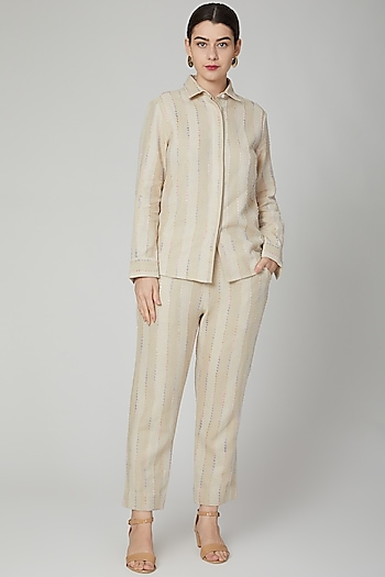 Nude Embroidered Linen Pants by Aruni