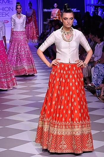 Red gota patti lehenga with contrast bandi by Anita Dongre