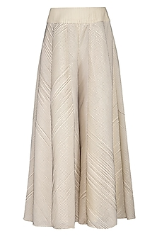 Cream pleated sharara pants by Aruni
