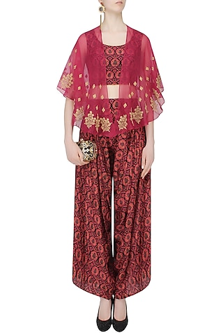 Red And Black Printed Crop Top And Cowl Pants Wih Red Embroidered Cape by Anoli Shah