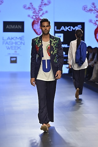 Deep navy floral embroidered coat by Aiman
