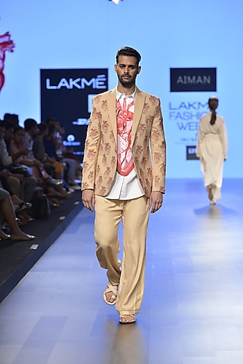 Nude heart embroidered mens coat by Aiman