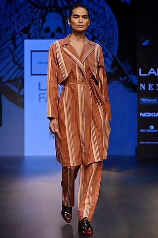 Rusty Orange Trench Jacket with Panel Detailing and Trousers by ARMAAN RANDHAWA