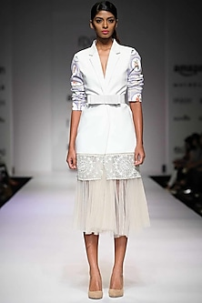 Off white printed pleated tulle skirt  by Archana Rao