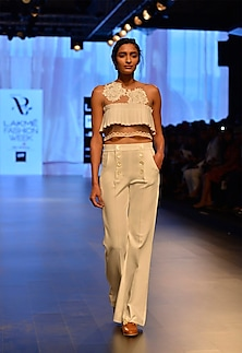 White lace appliqued ruffle crop top by Archana Rao