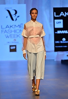 Powder blue lace culottes by Archana Rao