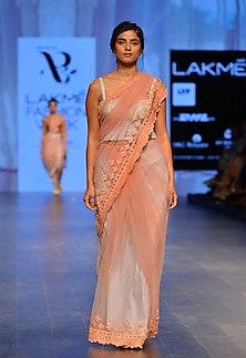 Peach pink embroidered saree by Archana Rao