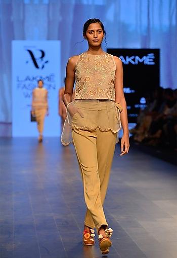 Nude neoprene pleated trousers by Archana Rao