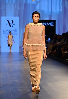 Nude neoprene sculpt skirt by Archana Rao