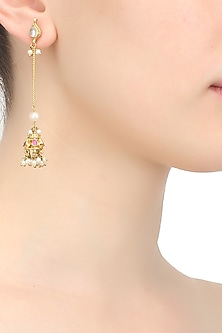 Gold finish kundan and red zircon chain hanging earrings by Art Karat