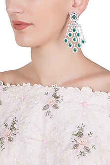 Silver plated diamond and emerald dangler earrings by Aster