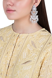 White glod plated faux diamond dangler earrings by Aster