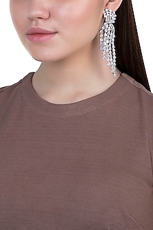 White rhodium plated zircon earrings by Aster