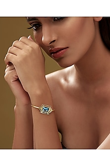 Gold Finish Lantern Bangle With Swarovski Crystals by Eina Ahluwalia X Confluence