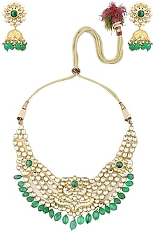 Gold finish kundan and green stone bridal necklace set  by Auraa Trends
