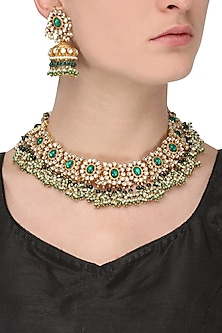 Gold finish kundan and green semi precious stone flower necklace set by Auraa Trends