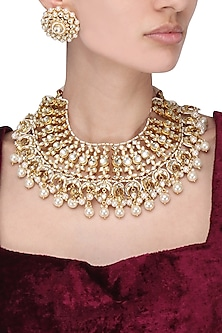 Gold finish kundan stone and pearl necklace set by Auraa Trends