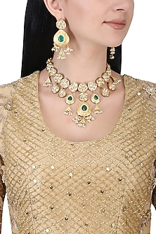 Gold plated kundan, green beads and pearls necklace set by AURAA TRENDS